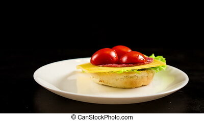 Preparing sandwich with cheese and vegetables in dish -...