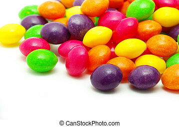 dragees - Set of sweet dragees of different color on white...