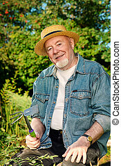 summer hobby - Portrait of a handsome senior man having a...
