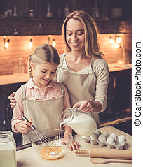 Mother and daughter baking - Cute little girl and her...