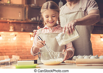 Father and daughter baking - Cute little girl and her...