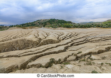 Earth cracks, formations created by natural gas. Dry land in...