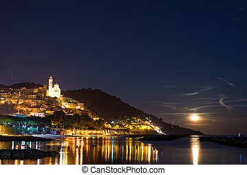 Starry sky and moonlight at glowing Cervo, Ligurian Riviera,...
