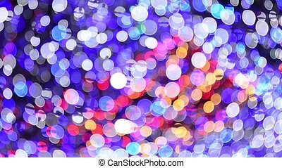 Abstract background of moving blurred colored lights garland