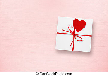 Gift box for Valentines Day on pink background