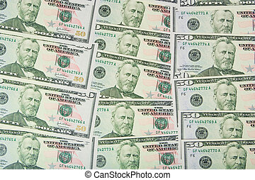 Background with many american fifty dollar bills