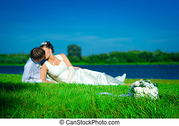 Newly married on a grass