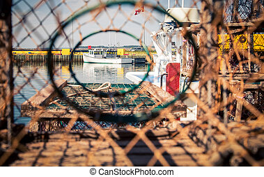 fishing boat thru a lobster trap - View of a fishing boat...