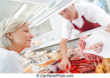 butcher with customer
