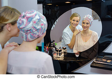 Beautician admiring woman's appearance