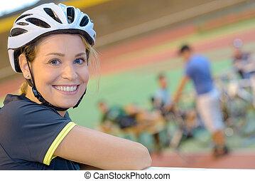 Portrait of lady wearing cycling helmet