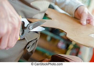 Craftsman cutting a pattern