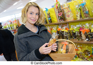 smiling girl choosing delicious ganaches praline and...