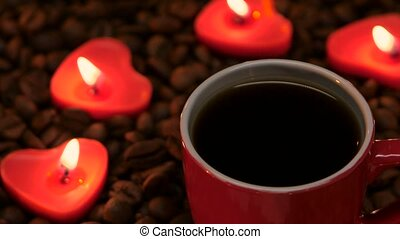 Cup coffee with candles in the shape of heart. Closeup - Red...