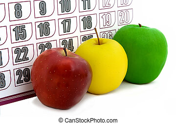 apple on background of a calendar