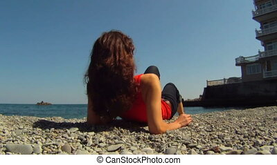 Girl lying on the beach