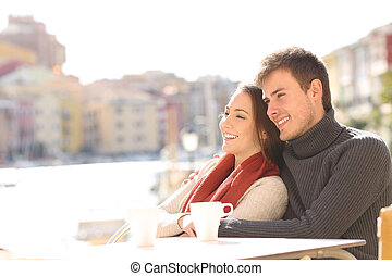 Couple relaxing in an hotel terrace on holidays