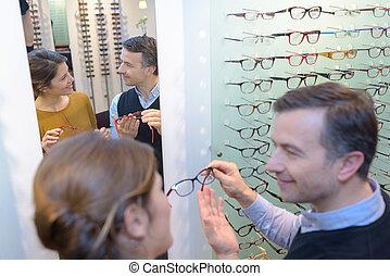 Optician advising female client