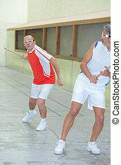 Two men playing jai alai