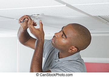 mending a light bulb