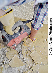 Using pneumatic device to break old tiles