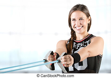 Woman Working Out With Elastic Bands