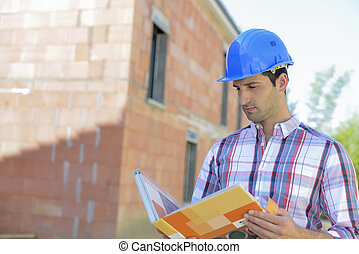 architect at building site