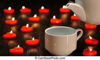 Nice little things in life - cup of coffee by candlelight -...