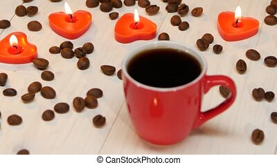 Candles in the shape of heart beside cup of coffee - Red...