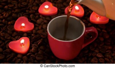 In Valentine's Day cup of coffee by candlelight. Slow motion...