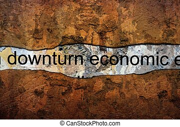 Downturn economic text on wall