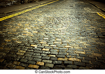 Cobblestone Street - Old cobblestone street in Europe with...