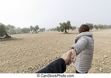 Woman holding the hand of a man