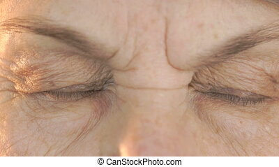 Woman's face with disturbing look of face
