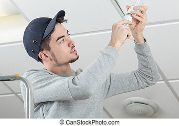 Man changing bulb
