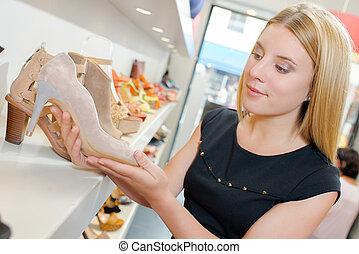 girl holding stiletto