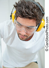 man wearing goggles and earmuffs