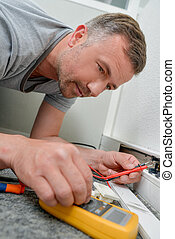 man repairing an outlet