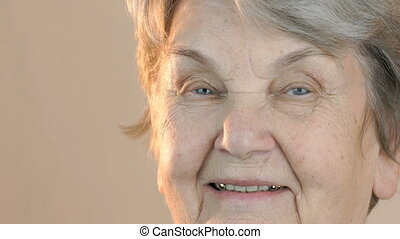 Portrait of a elderly smiling woman. Close up
