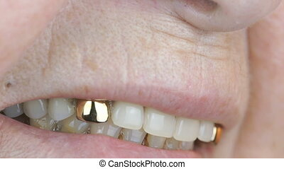 Old woman aged 80s smiling with false teeth