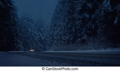 Cars Drive Through Snowstorm In The Evening - Moving shot of...