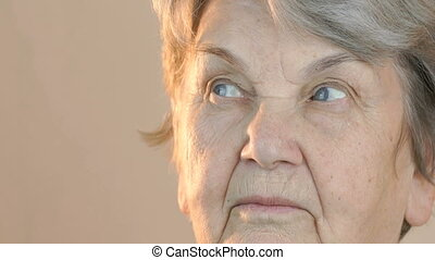 Elderly woman looking in side. Face close up