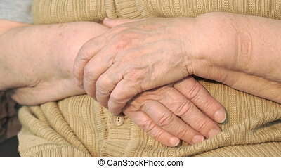 Old woman hand with wrinkled skin. Close up