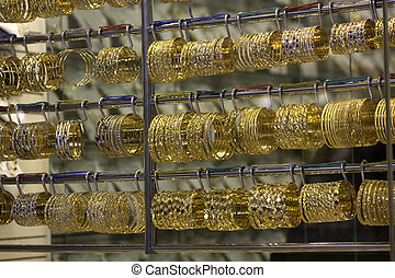 Dubai gold souq bangles - Gold bracelets and bangles in a...