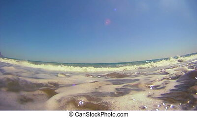 Sea waves - Beautiful sandy beach with calm sea.