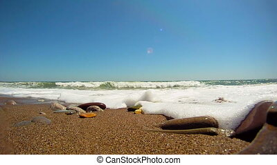Wave covers - Foamy ocean waves on a sandy shore. Wave...