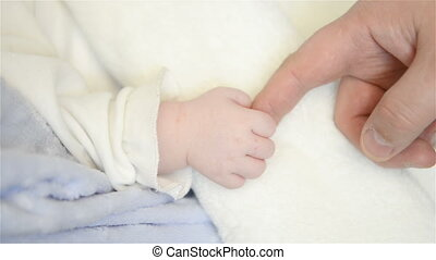 newborn infant baby's hand - Father holds newborn infant...