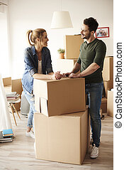 Talking couple during moving house