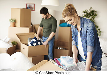 Waist up of moving house couple