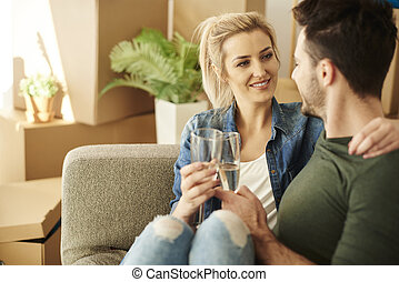 Couple chilling on the sofa with drinks